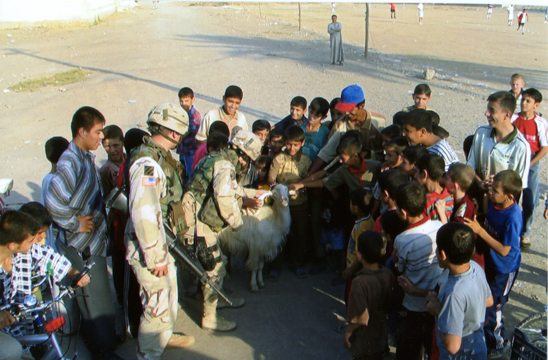 Picture of US troops with Iraqi citizens on election day.